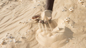 Man holding some sand in the hand Stock Photography