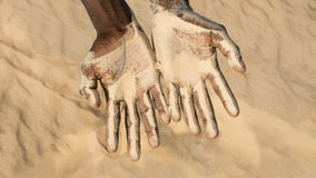 Man holding some sand in the hand Stock Photo