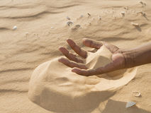 Man holding some sand in the hand Royalty Free Stock Images