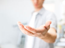 Man holding something on his hand Royalty Free Stock Images