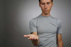 Man holding something on his palm Stock Photography