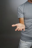 Man holding something on his palm Royalty Free Stock Photo