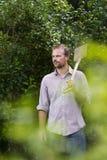 Man holding spade. In garden Stock Photos