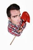 Man holding spade Stock Photo