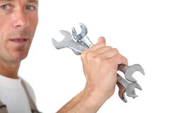 Man holding spanners Royalty Free Stock Photo