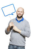 Man holding a speech bubble sign smiling Royalty Free Stock Images