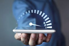 Man holding speedometer with KPI word. Key Performance Indicator stock photos