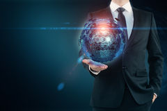 Man holding sphere Stock Images