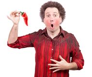 Man holding a spicy red paprika. Isolated on white background Royalty Free Stock Image