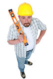 Man holding spirit level Stock Images