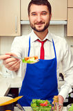 Man holding spoon with salad Royalty Free Stock Images