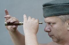 Man holding  a spyglass Stock Photos
