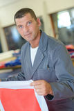 Man holding square fabric Royalty Free Stock Image