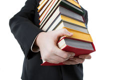 Man holding a stack of books Stock Images
