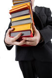 Man holding a stack of books Stock Photo