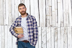 Man Holding Stack Of Books Royalty Free Stock Photography