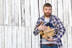 Man Holding Stack Of Books Stock Photo