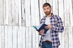 Man Holding Stack Of Books Royalty Free Stock Image
