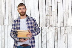 Man Holding Stack Of Books Stock Photography