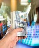 Man holding stack of dollar bills Stock Photos