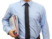 Man holding stack of folders Pile and going to work or to manage Royalty Free Stock Image