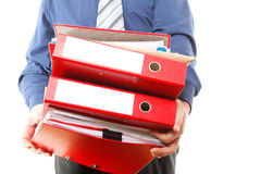 Male office worker carrying a stack of files Royalty Free Stock Images