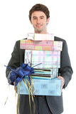 Man holding stack of gift boxes Royalty Free Stock Image