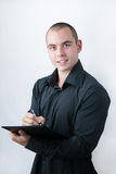 Man holding stack of papers and writing Royalty Free Stock Photos