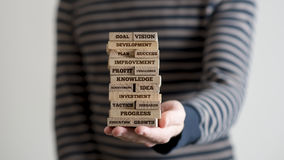 Man holding stack of wooden bricks Royalty Free Stock Photos