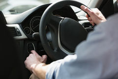 Man holding a steering wheel. In his car Stock Image