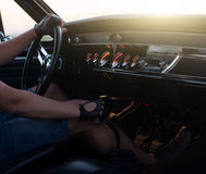 Man holding steering wheel inside car at sunset. Man holding steering wheel inside car at the sunset Royalty Free Stock Photos