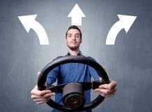 Man holding steering wheel Stock Photo
