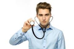Man holding stethoscope Royalty Free Stock Photos