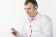 Man is holding stethoscope Stock Photos