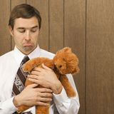 Man holding a stuffed animal Stock Images