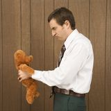 Man holding a stuffed animal Royalty Free Stock Photo