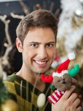 Man Holding Stuffed Toy In Christmas Store Royalty Free Stock Images