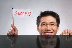 Man holding success flag Royalty Free Stock Photo
