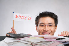 Man holding success flag Stock Photography