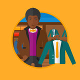 Man holding suit jacket in clothing store. Stock Images