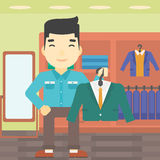 Man holding suit jacket in clothing store. Royalty Free Stock Images