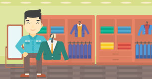 Man holding suit jacket in clothing store. Royalty Free Stock Photos