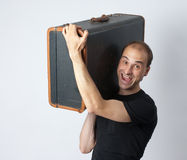 Man holding an suitcase Stock Photo