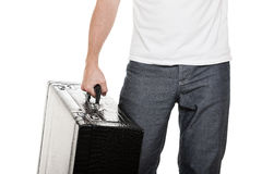 Man holding suitcase in hand Royalty Free Stock Image
