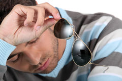 Man holding sunglasses Stock Photo