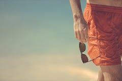 Man Holding Sunglasses On Beach Royalty Free Stock Image