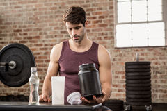 Man holding supplement tin. At the gym Stock Photography