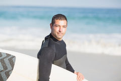 Man holding surfboard on the beach. On a sunny day Royalty Free Stock Image