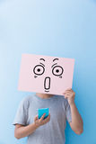 Man holding surprise expression billboard stock photo
