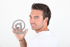 Man holding at symbol Stock Images